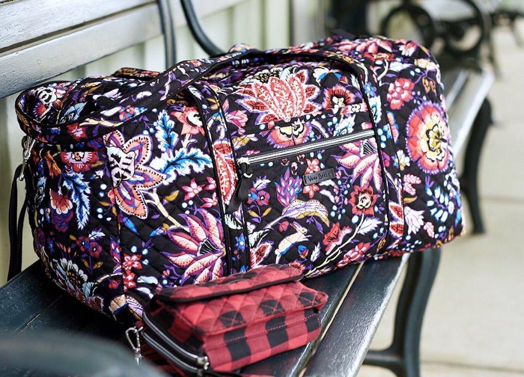 Vera Bradley Large Travel Duffel Bag in Foxwood on park bench