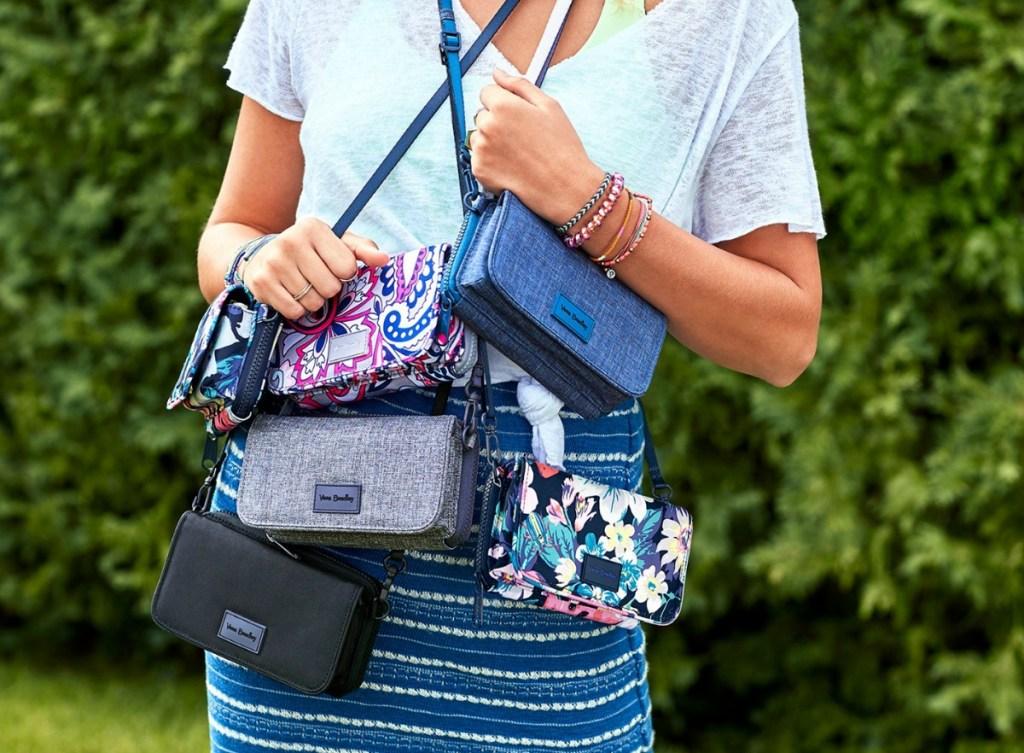 woman holding multiple purses