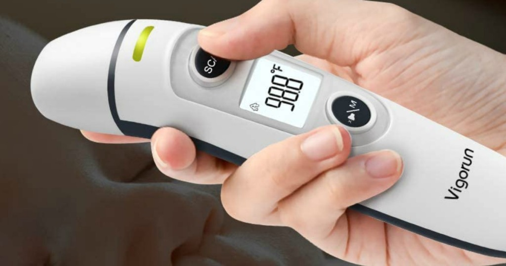 digital thermometer in hand