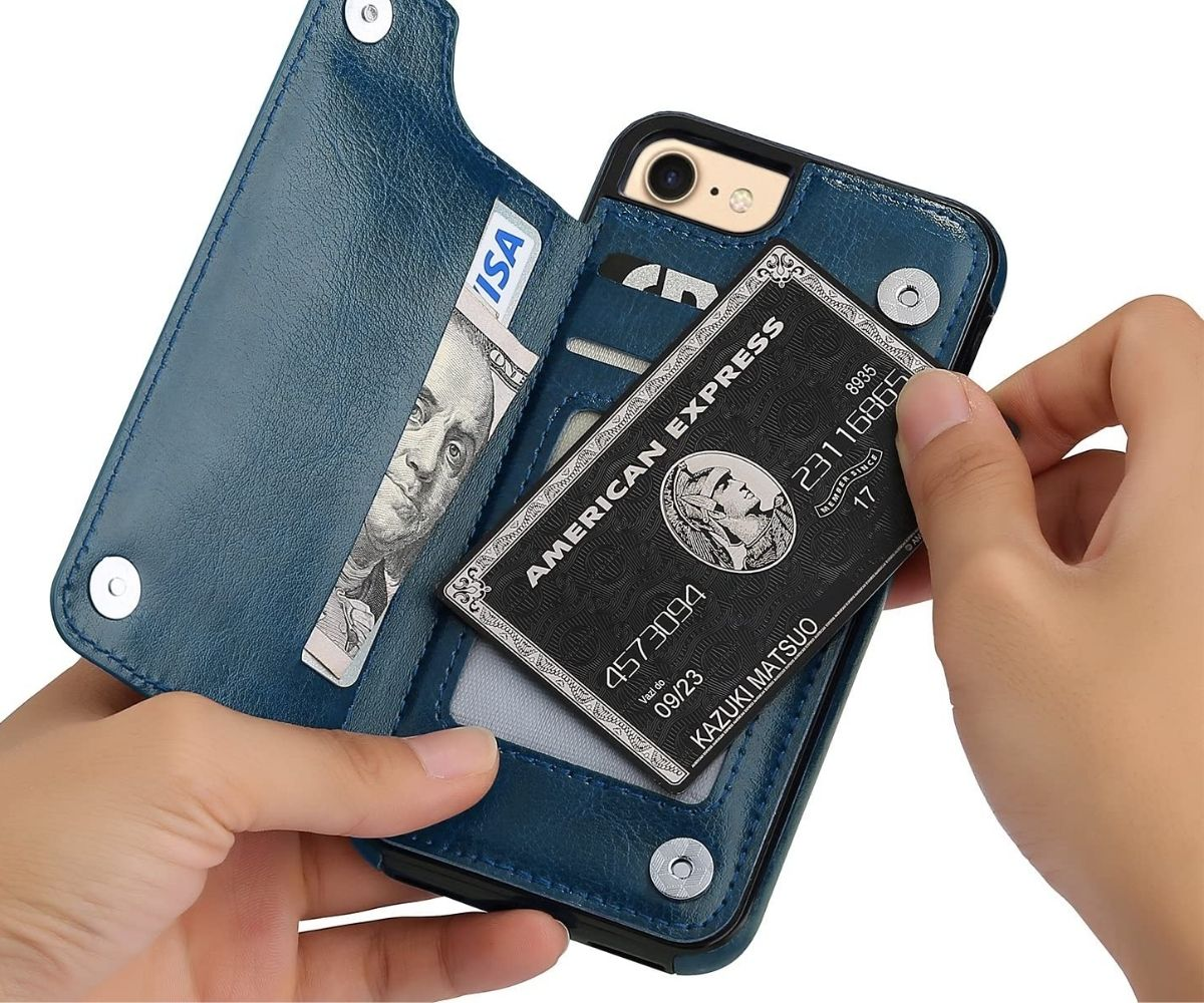 A hand placing a credit card in a wallet phone case