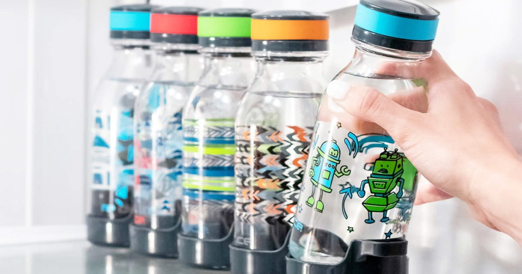 person grabbing a robot print kids water bottle out of fridge from a set of five bottles