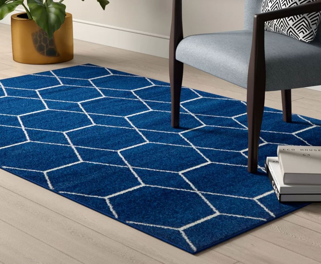 navy blue area rug with white geometric print