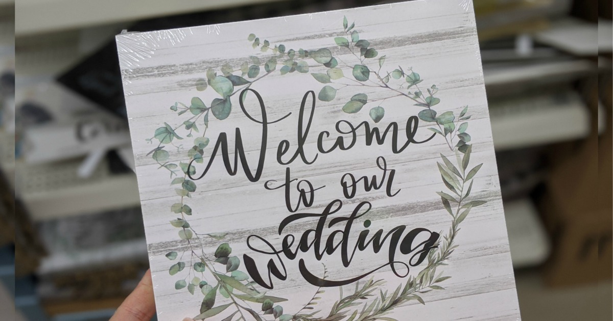 hand holding Wedding Sign from Dollar Tree