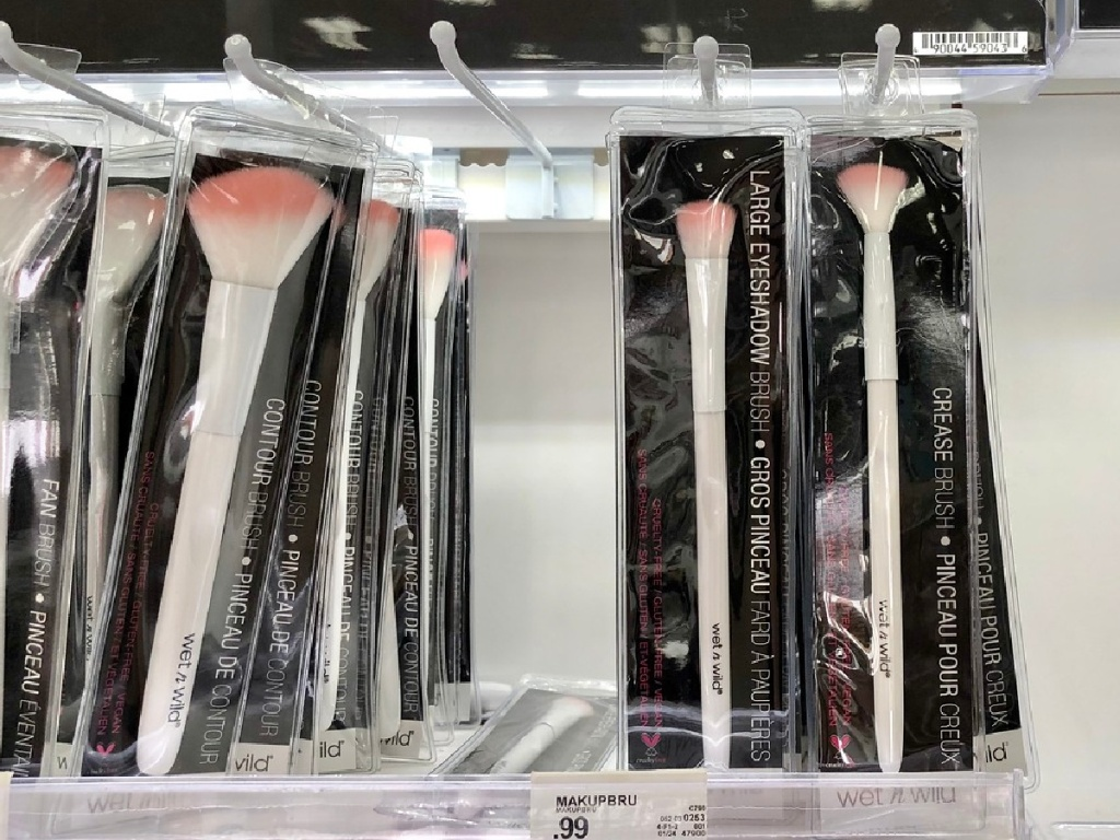 wet n wild makeup brushes hanging on a store rack