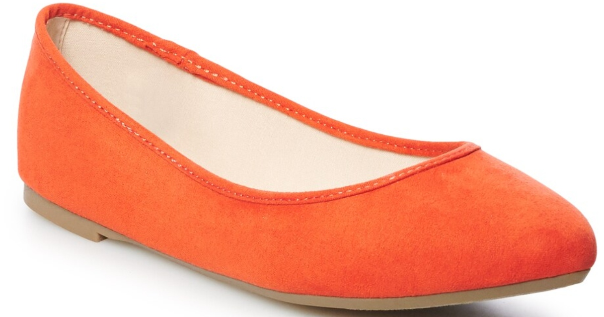the right shoe of a women's pointed toe flat in orange