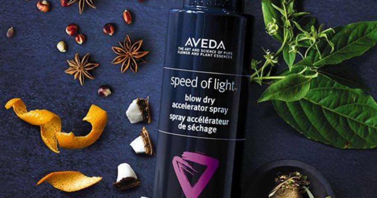 Aveda speed of light blow dry spray with flowers in background