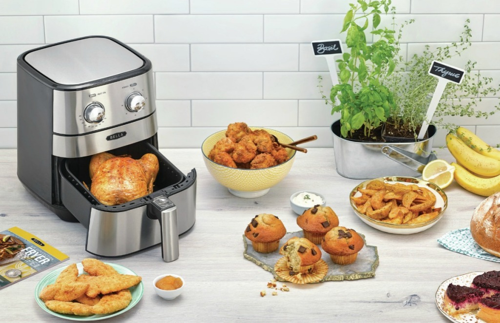 bella air fryer surrounded by fried foods