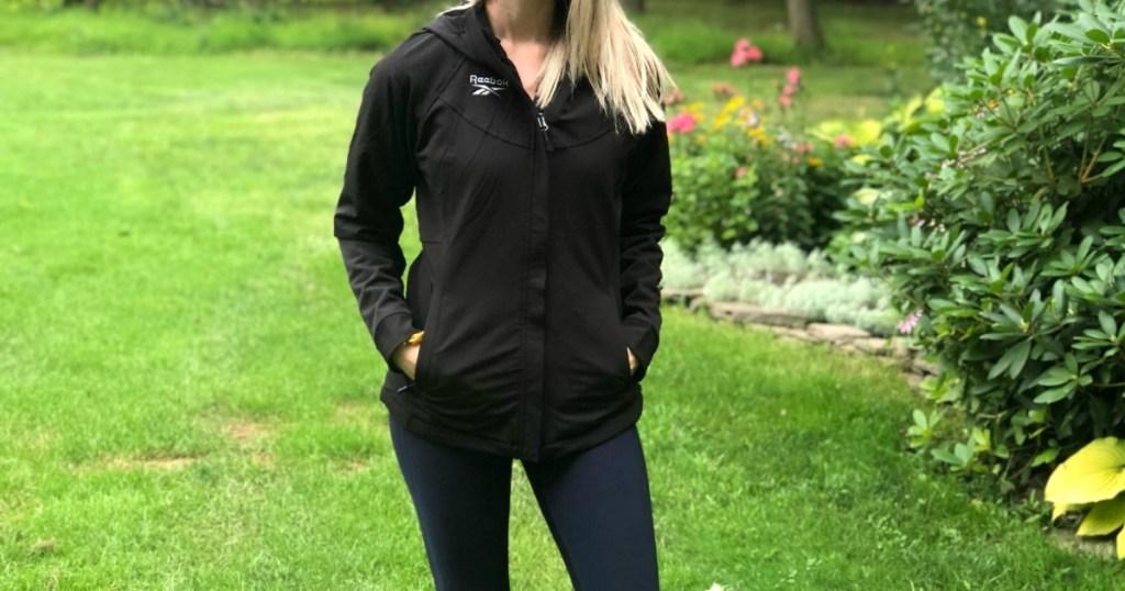 woman wearing black reebok jacket
