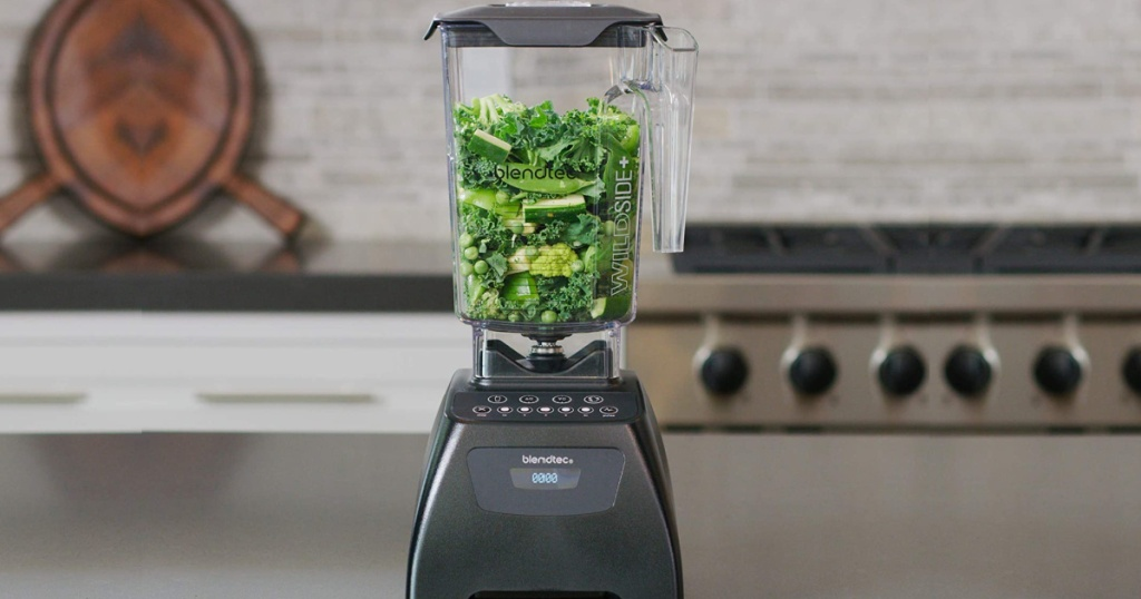 blendtec wideside blender with brocolli in it