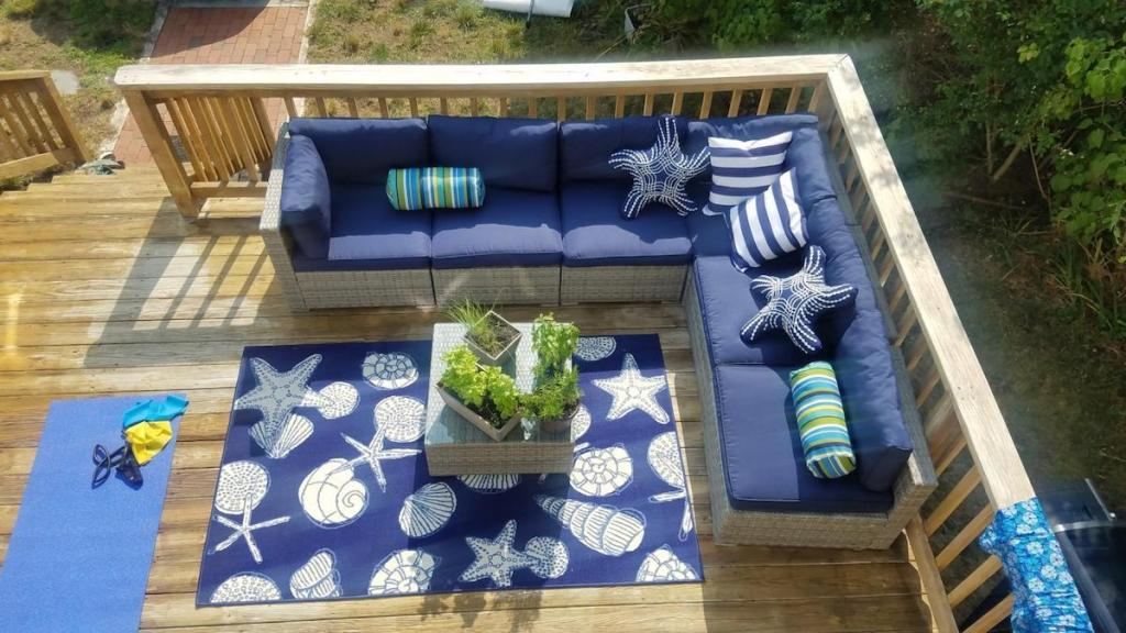 blue and gray outdoor wicker furniture on deck