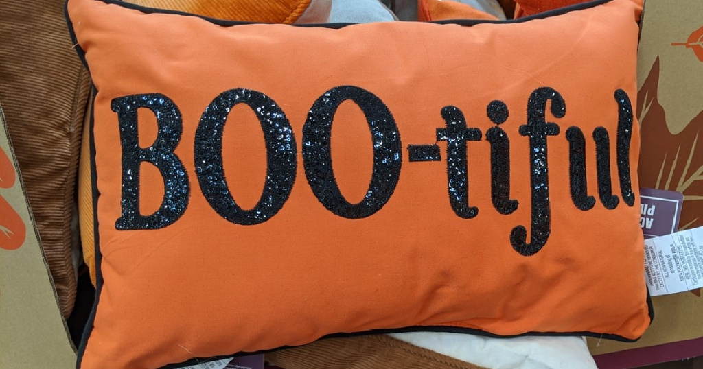 orange pillow with words, 'boo-tiful' on it