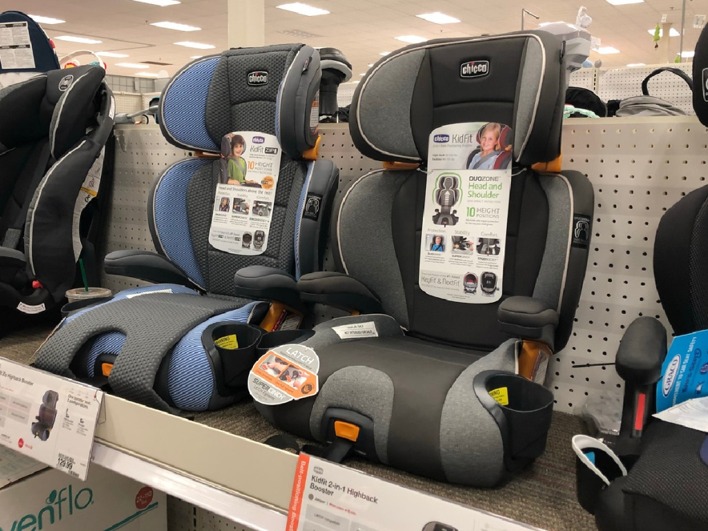 several car seats lined up on display in a store