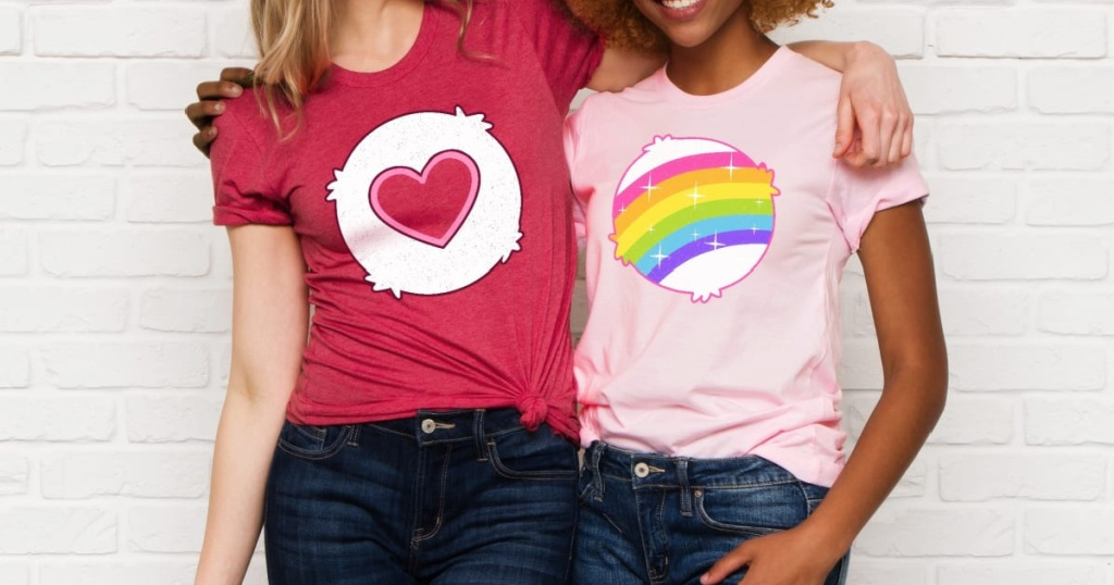 two womean wearing tshirts with carebear pictures on them