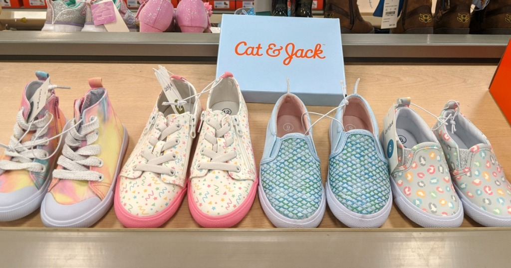 colorful kids printed sneakers on a store shelf