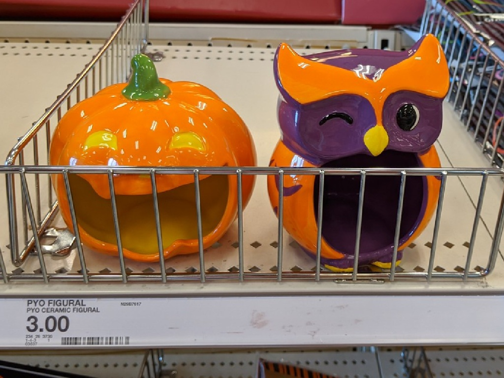 owl and pumpkin figures on store shelf