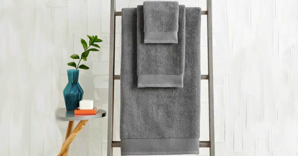 gray towels on a ladder rack