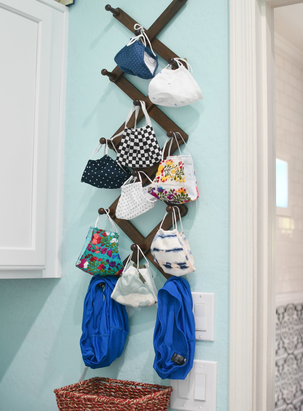 clean masks hanging on a wood expandable rack