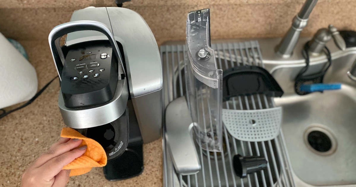 cleaning off a Keurig with a damp rag