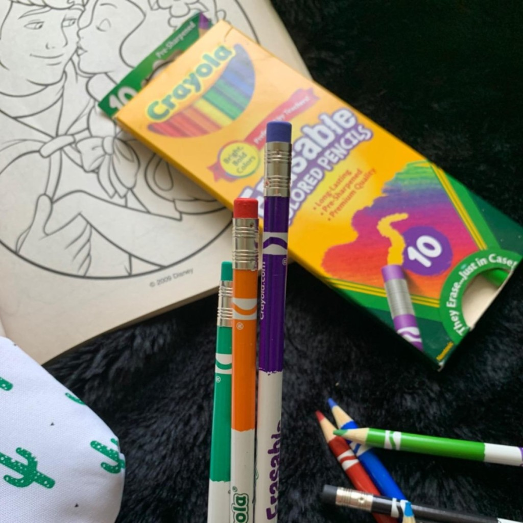 holding Crayola Erasable Colored Pencils in front of box
