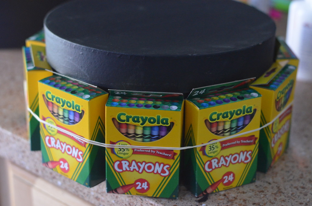 Crayola crayons packs attached to box with rubber bands