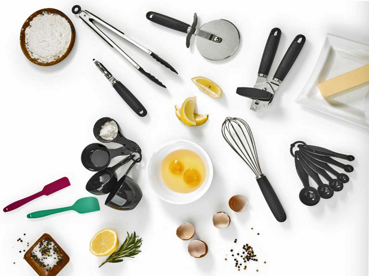 cooking and baking gadgets on a table with spices, lemon wedges and raw eggs in a bowl