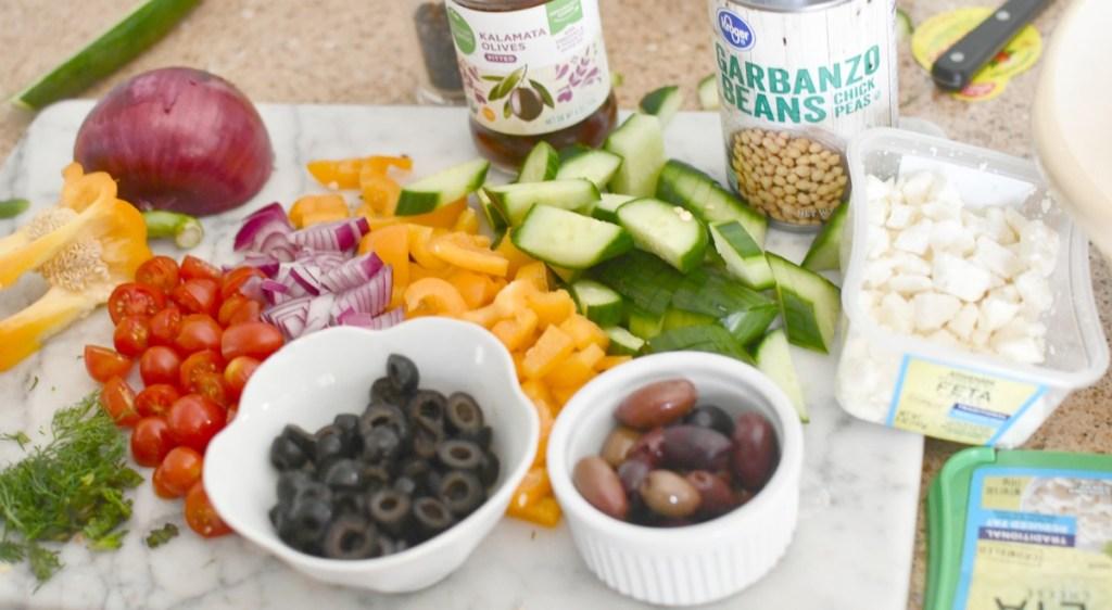 cut up ingredients for greek salad