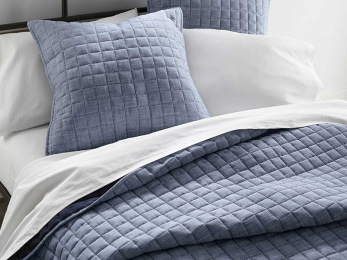 up close picture of denim bedding