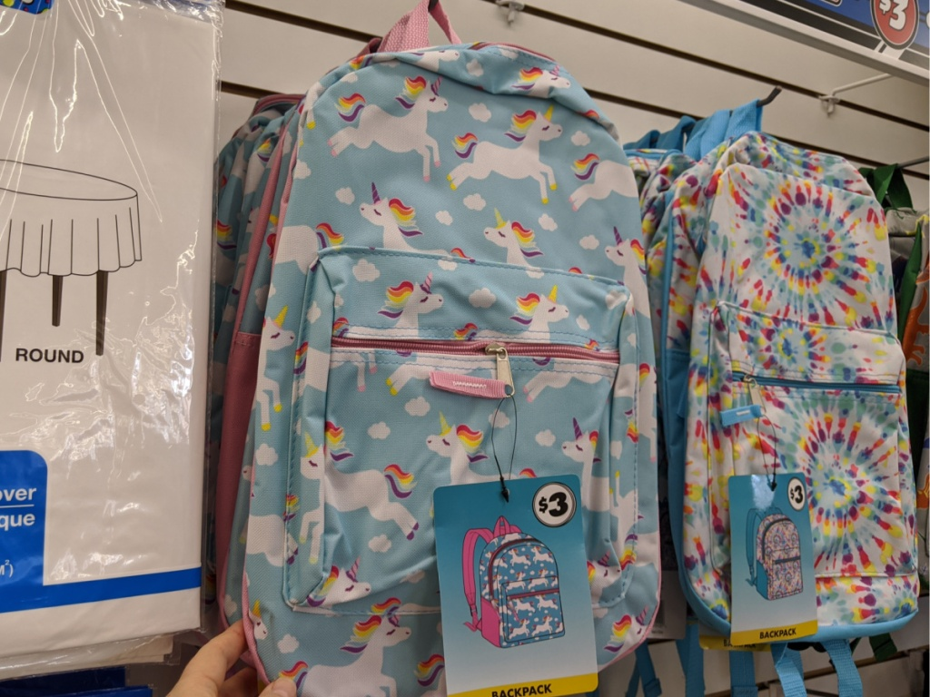 unicorn backpack and tie die backpack hanging in store
