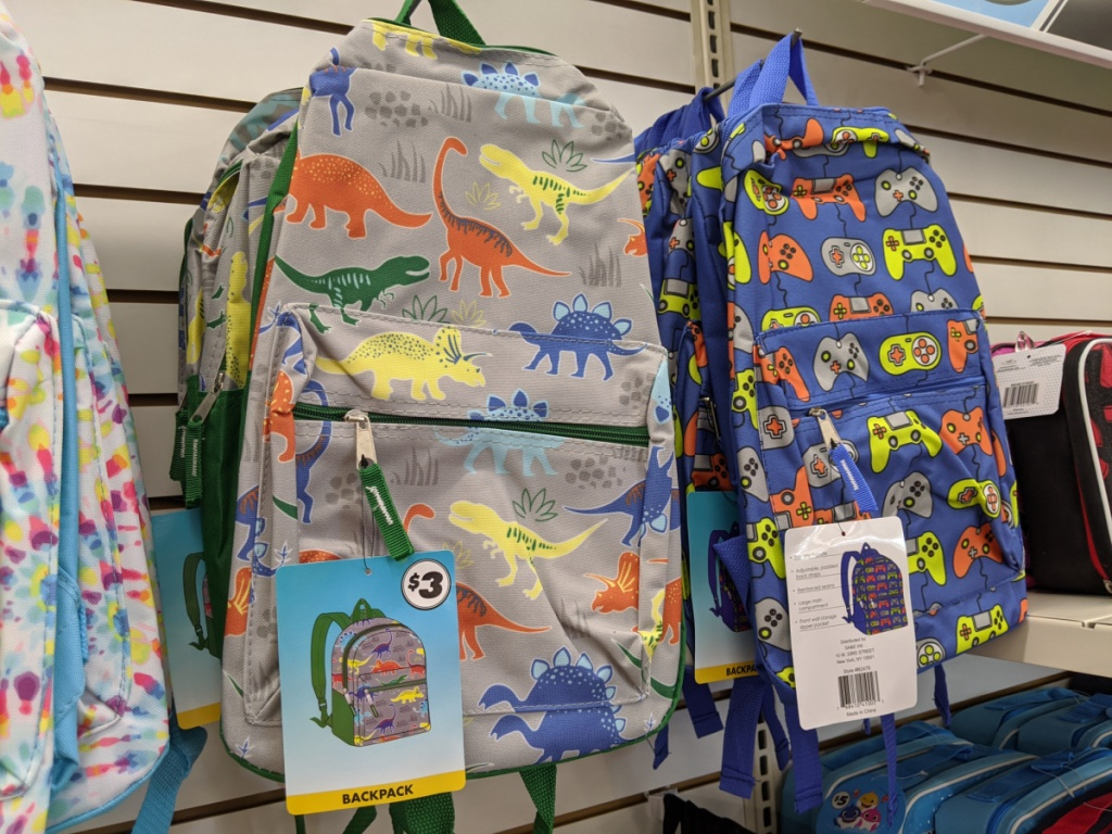 dinosaur backpack and video game controls backpack