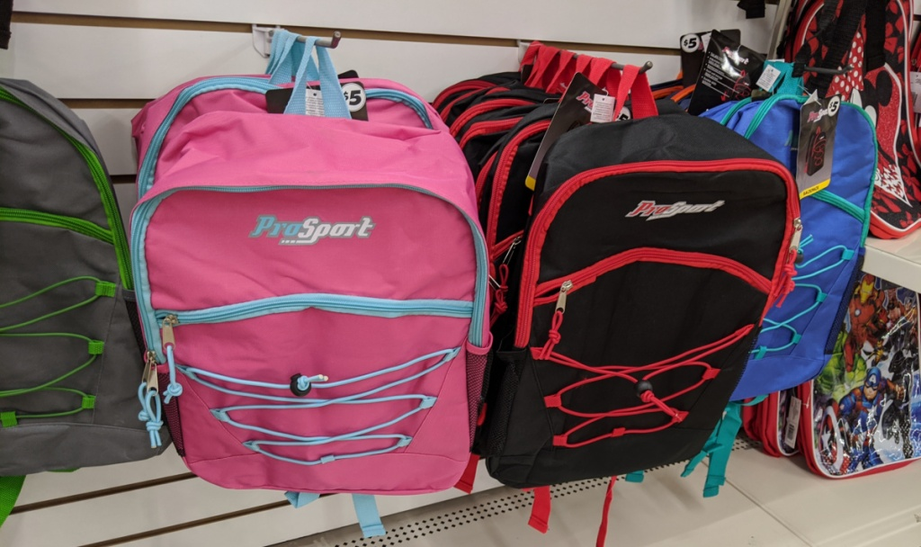 prosport pink and black backpacks hanging in store