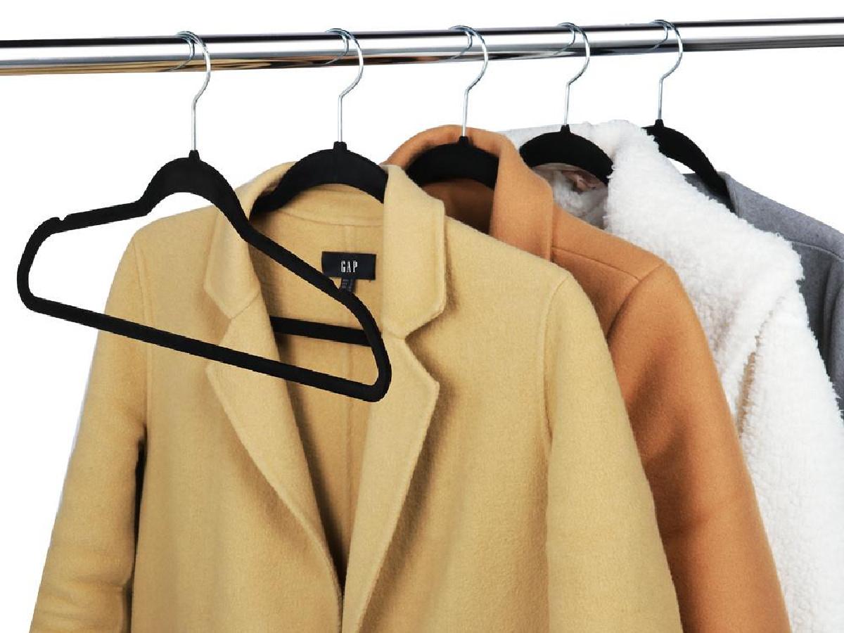 black velvet hangings holding thick coats