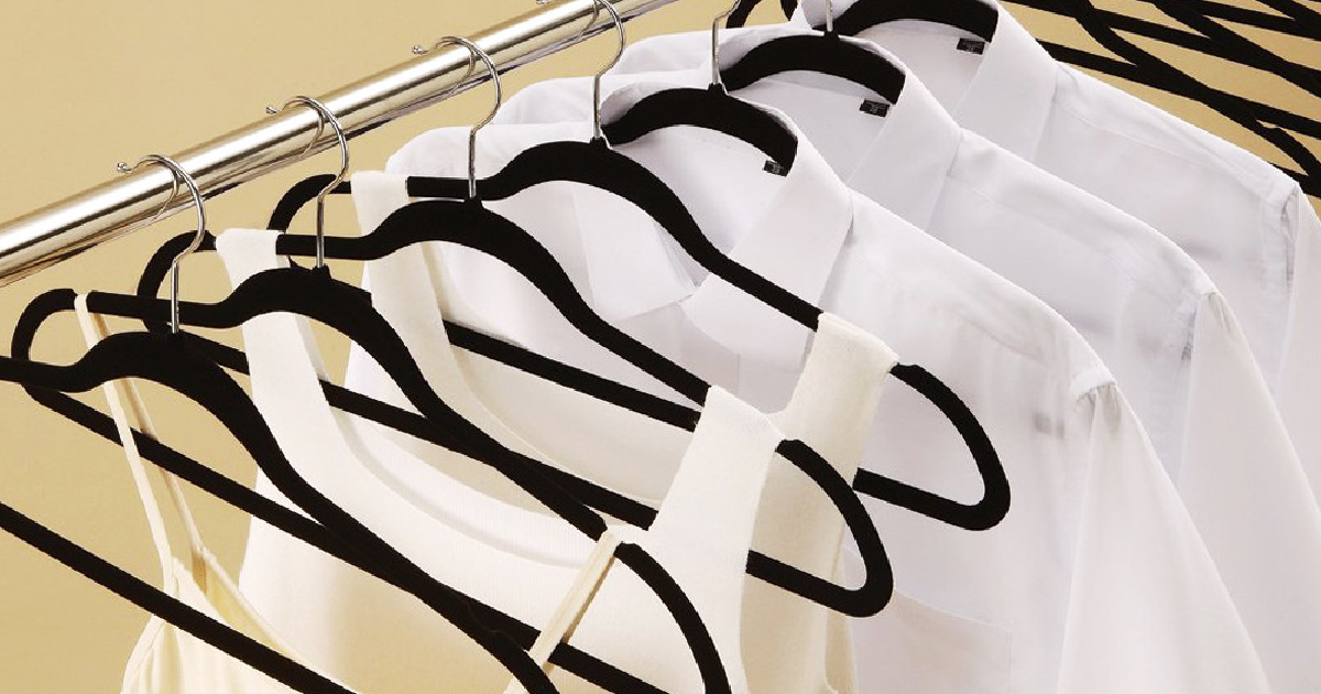 black felt hangers holding white clothing