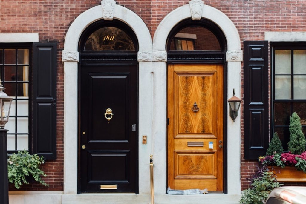side by side of two front doors