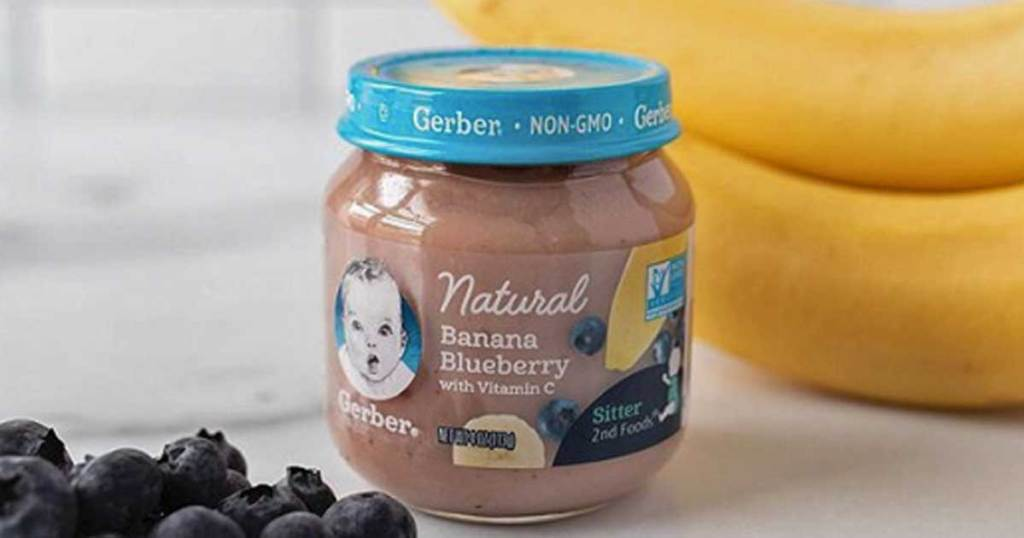 baby jar next to blueberries and bananas