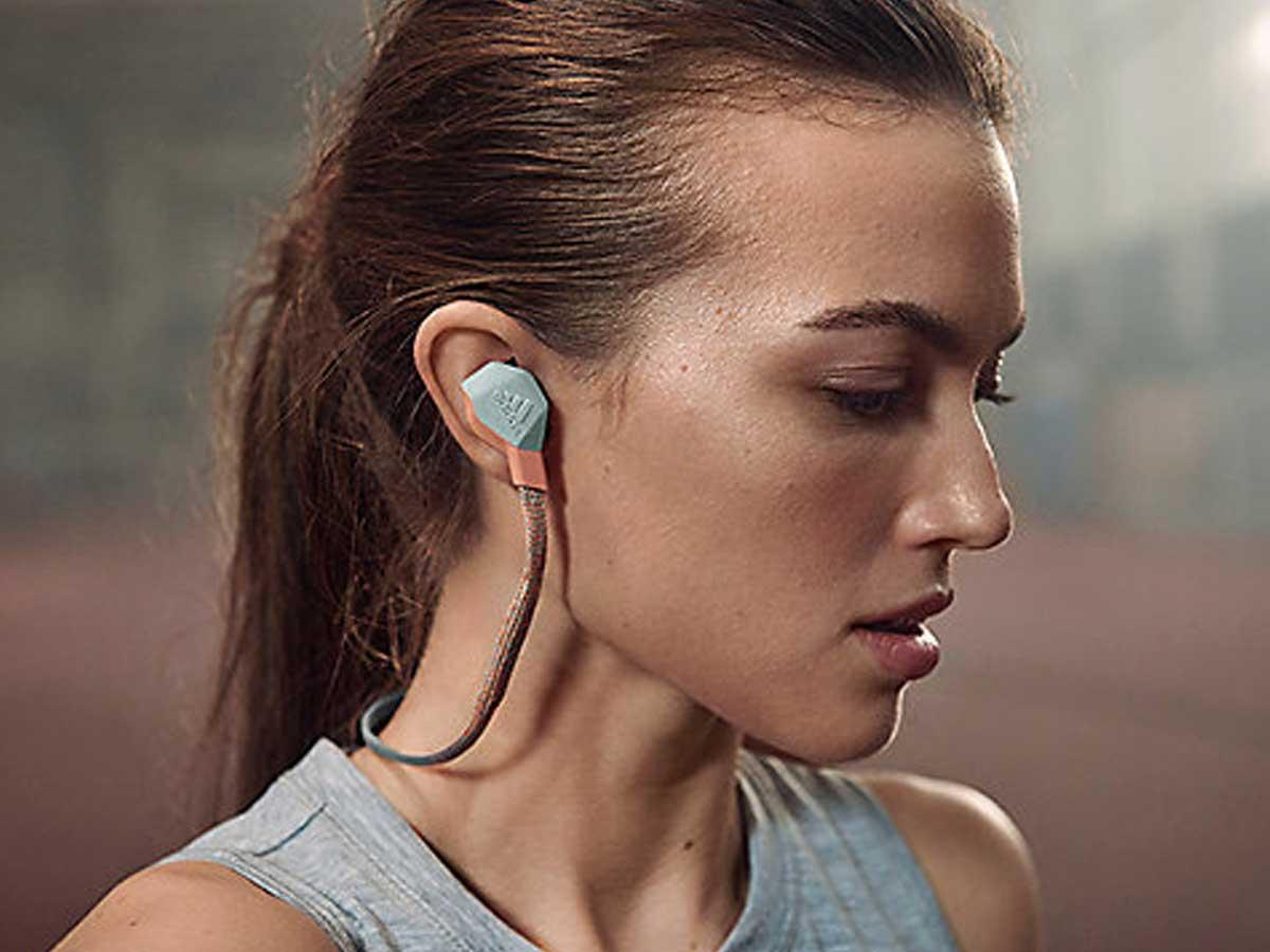 woman wearing in ear headphones