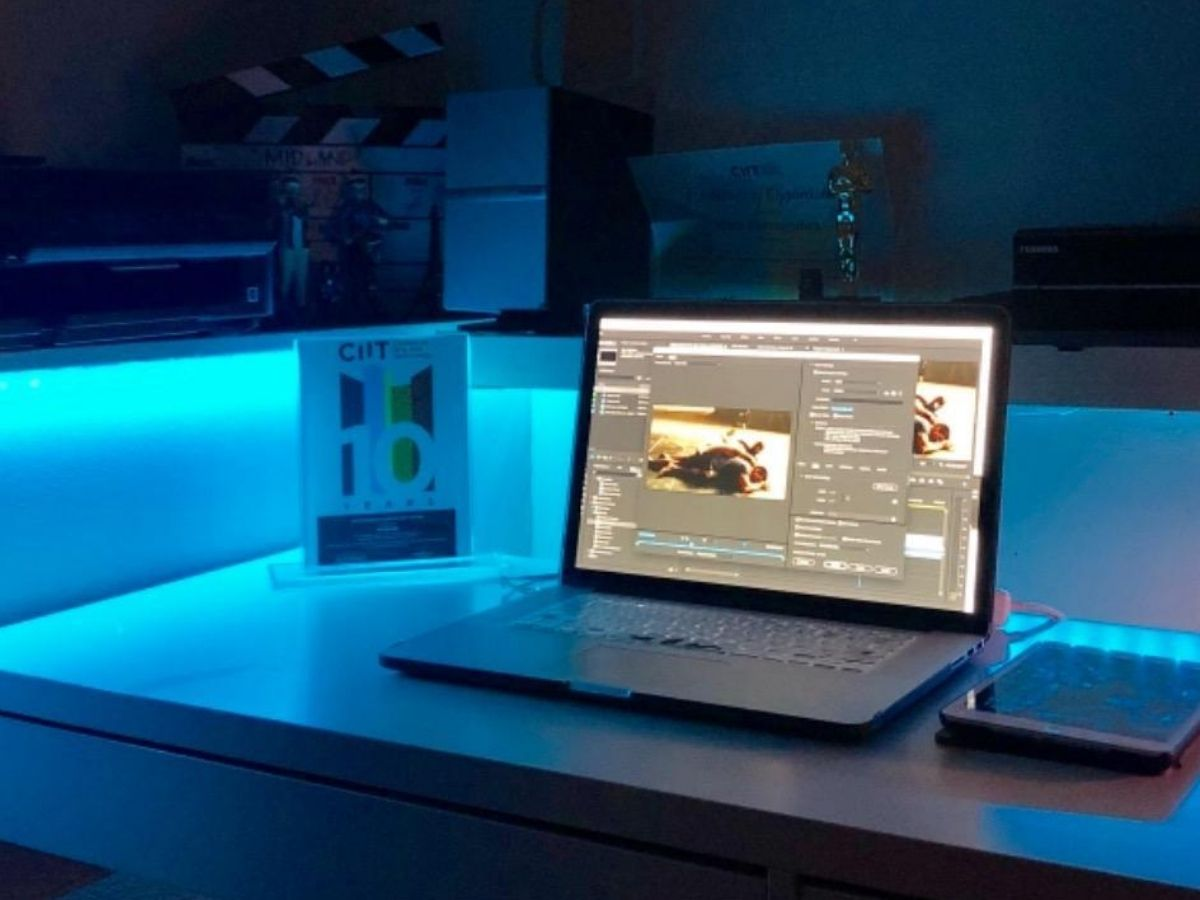 desk with laptop and ipad on it