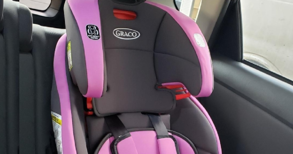 purple and black carseat in car