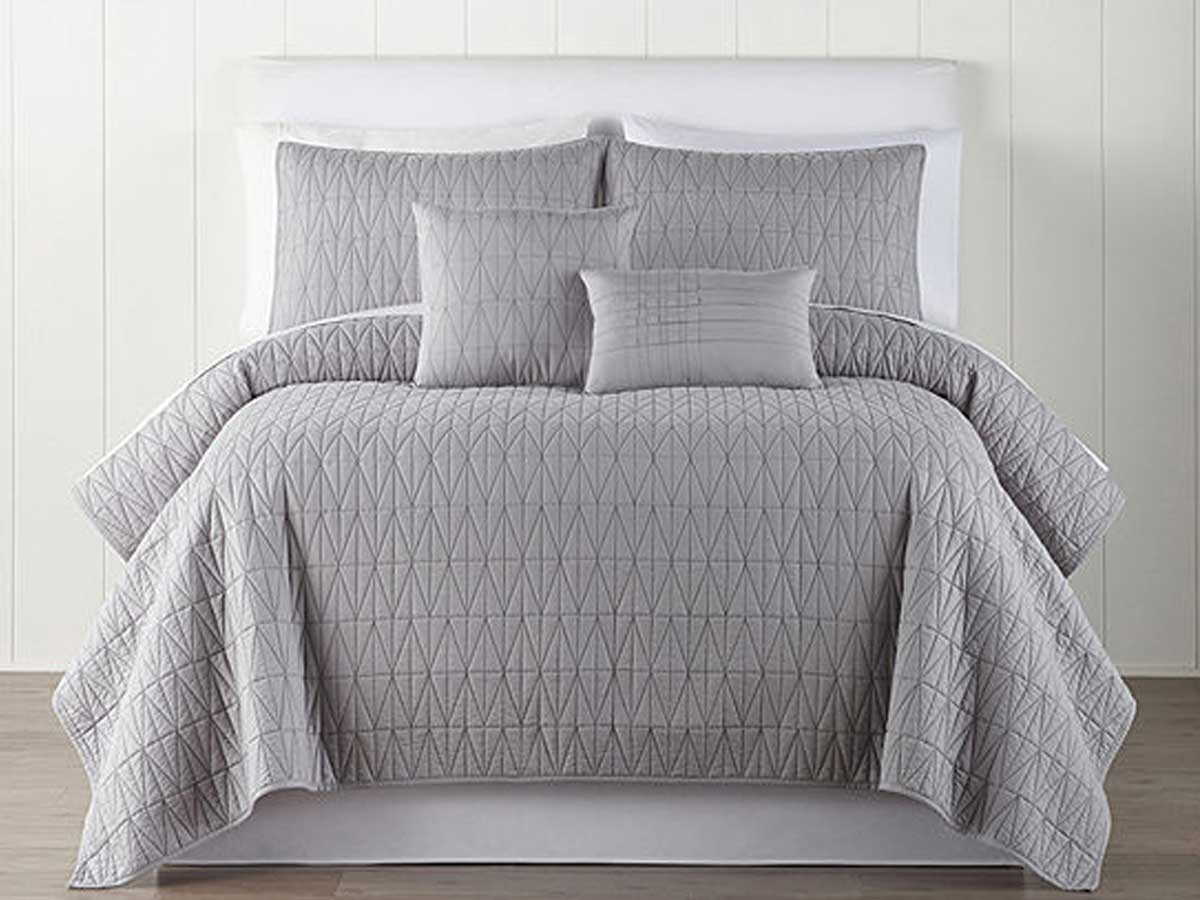 gray quilt on a bed