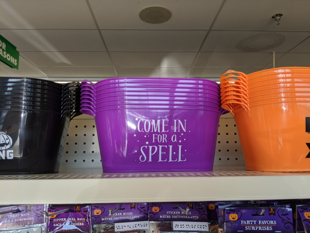 plastic buckets with handles with halloween decor on them