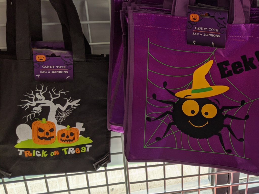 store shelf with halloween tote bags on it
