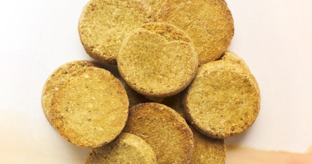 dog treats that are beige and round