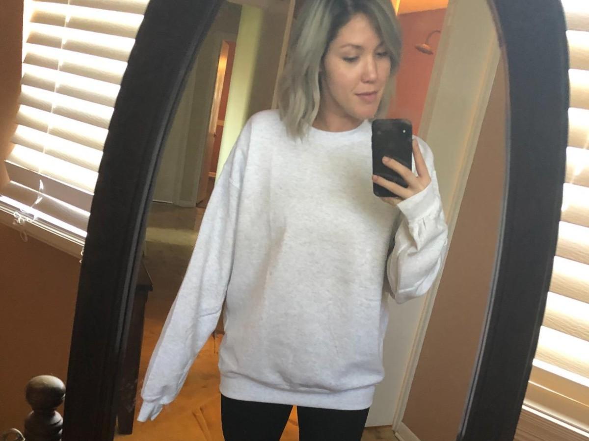 woman taking selfie in mirror