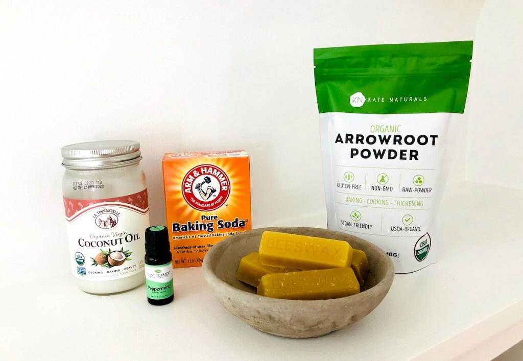 ingredients for homemade deodorant on white shelf