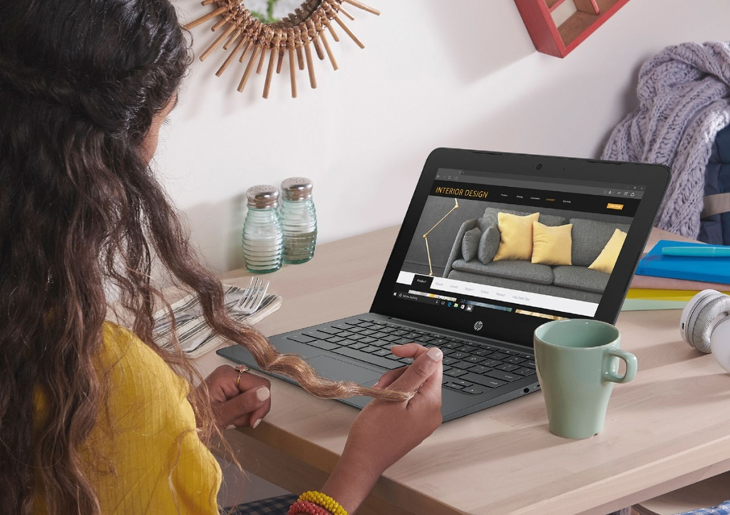 woman at laptop computer with cup of coffee