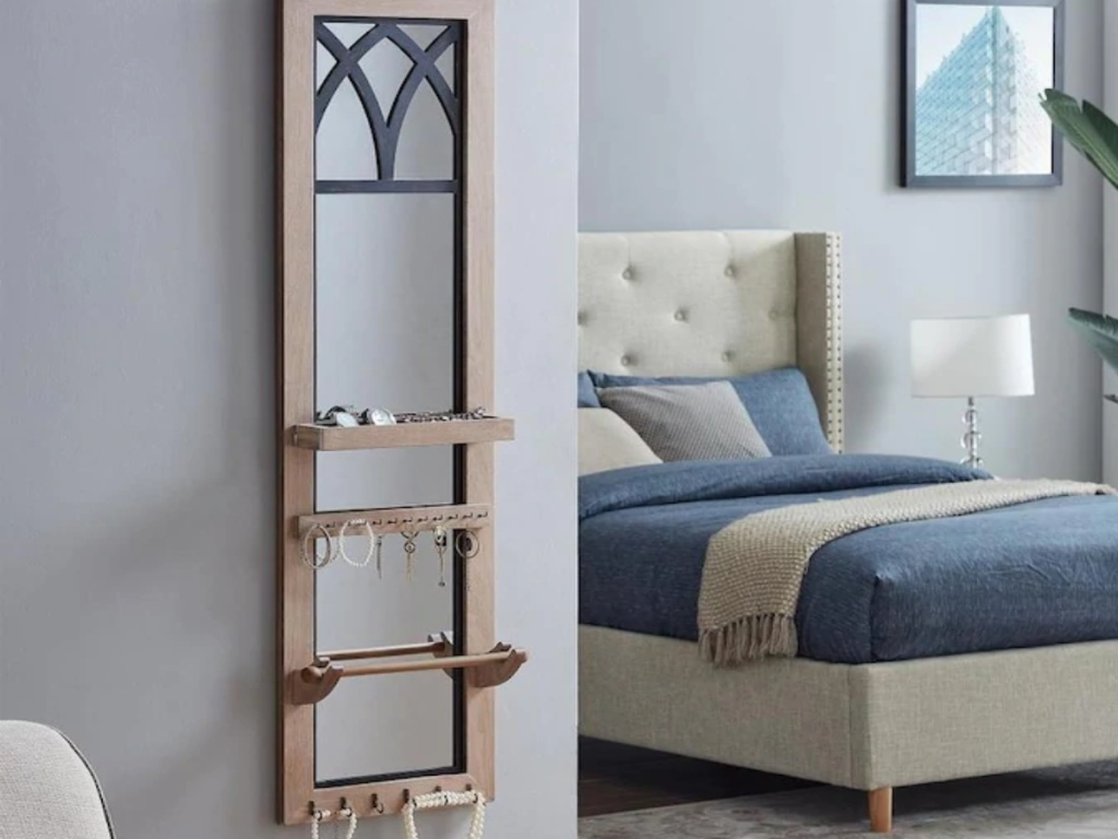 Jewelry organizer on a wall in a bedroom