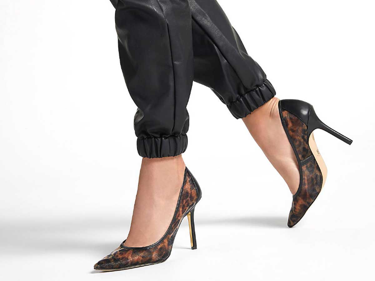 woman wearing leather pants and leopard pumps