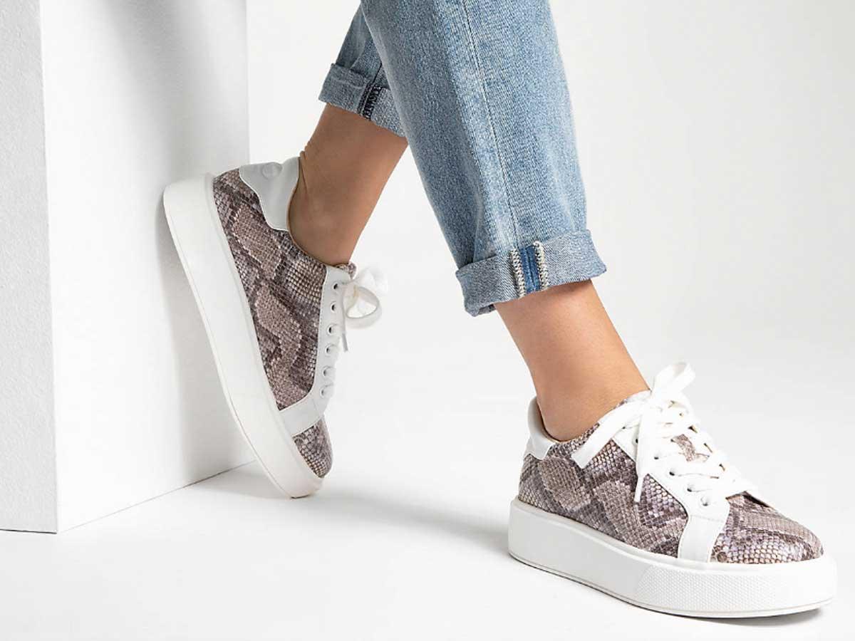 woman wearing platform sneakers