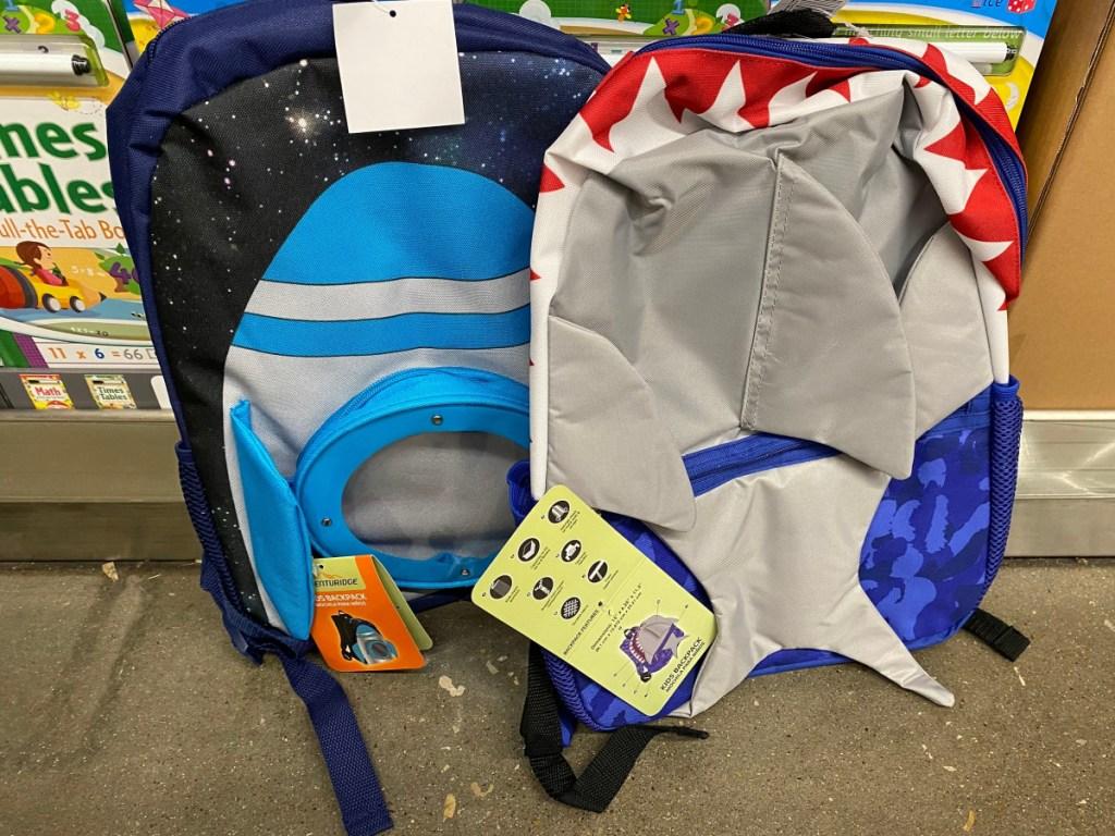 spaceship and shark backpacks