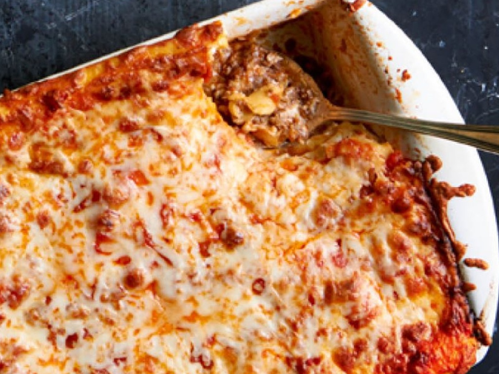 pan of lasagna with serving spoon in it