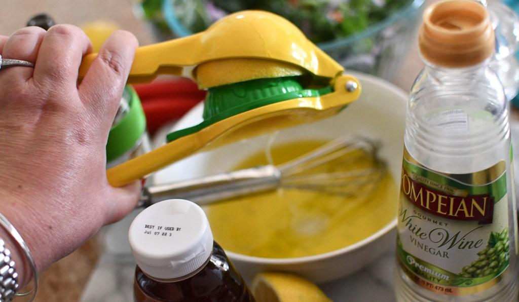 using citrus lemon juicer to squeeze lemon for juice